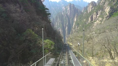 West Sea Canyon funicular in Huangshan mountains in China. Cable railway that descends to the Xihai Great Canyon. Breathtaking view traveling down mountain in popular Chinese tourist spot.