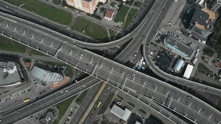 Take off upward. Interlacing of roads. Automobile problems of the city. The center of a large city. A multifaceted highway. The camera is watching the car. A box on the road. Patterns of roads | Shutterstock HD Video #1014507689
