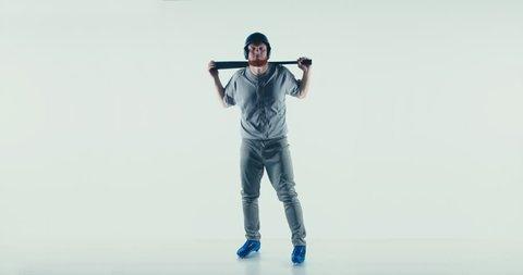 Caucasian professional baseball player batter posing isolated on white background. 4K UHD 60 FPS SLOW MOTION