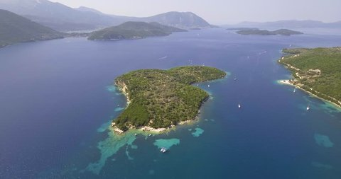 Amazing aerial video of Thilia island in Greece. In distance is famous Scorpios island, from the left side is Lefkada island and from right is a part of Meganisi island. Drone video in 4K resolution.