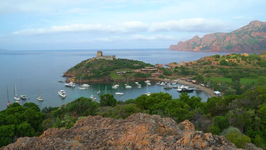 Video of Girolata Bay in Corsica Island, Corse-du-Sud, France. This anchorage place has 5 restaurants which get about 1000 visitors daily in August. It cannot be reached by car, only by walking or boat