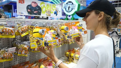 Female Customer Playing With Minions In Toy Store. Bangkok, Thailand, 12 May, 2018.