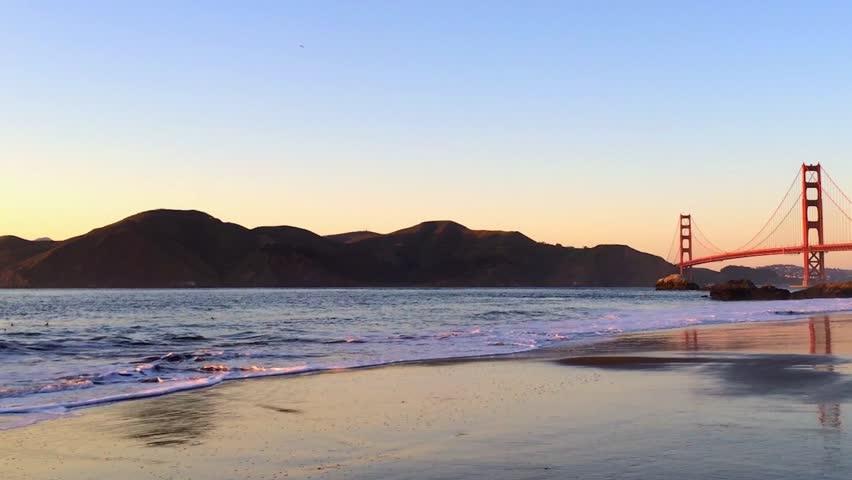 The Golden Gate Bridge at sunset, as seen from Baker Beach, San Francisco, California, USA