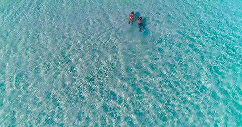 a couple doing snorkeling in a lagoon in French Polynesia