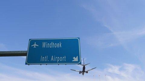 windhoek airport sign airplane passing overhead