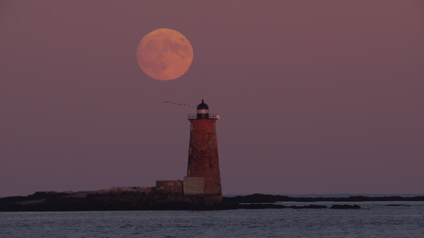 A Super Moon Rising Over Whaleback Lighthouse Viewed From New Hampshire