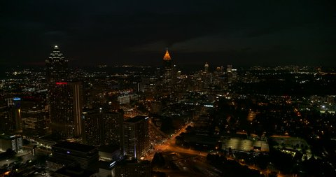 Atlanta Aerial v465 Flying through downtown over freeway with cityscape view at night 7/18