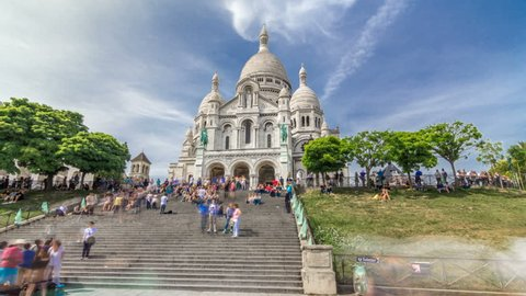 Tourists near the Basilica of the Sacred Heart of Paris (Sacra-Coeur) is a Roman Catholic church timelapse hyperlapse. Located at the summit of the butte Montmartre. Paris, France.