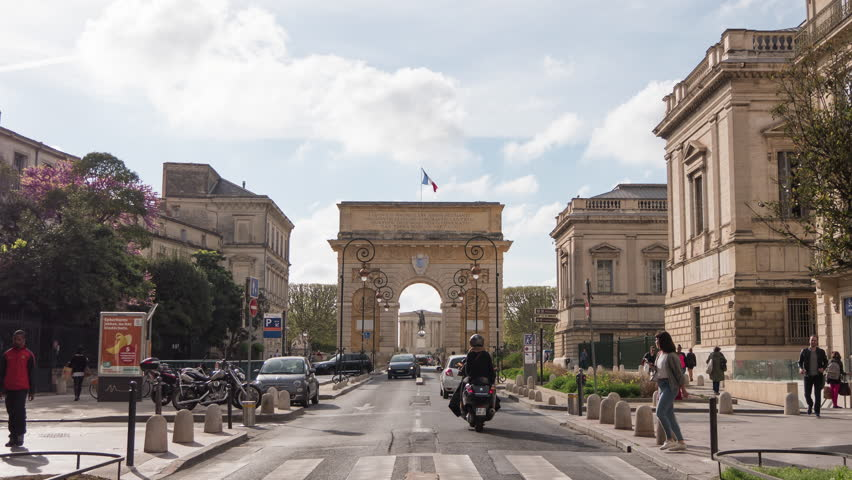 Montpellier, France - May, 2017: Timelapse of the Foch street and Porte Du Peyrou, in Montpellier.