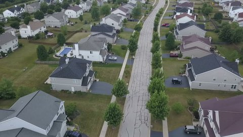 Aerial of a suburban neighborhood with large homes