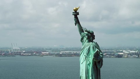 Aerial helicopter tour Statue of Liberty New York overlooking harbor