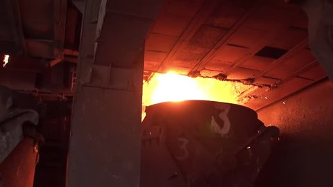 Smelting of liquid metal from blast furnace into the railway scoop container at the metallurgical plant