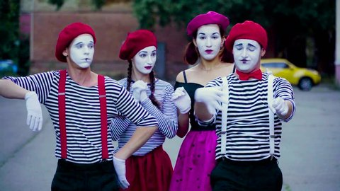 Four funny mimes imitate car accident at the city