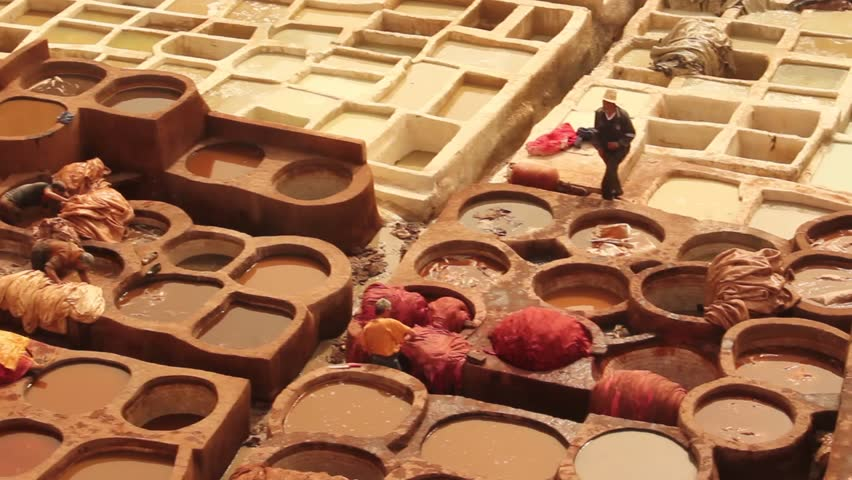 Men working the Tannery in Fez, dyeing the leather,
