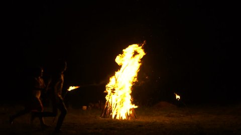 A large bonfire burns in the night, Russian folk traditions