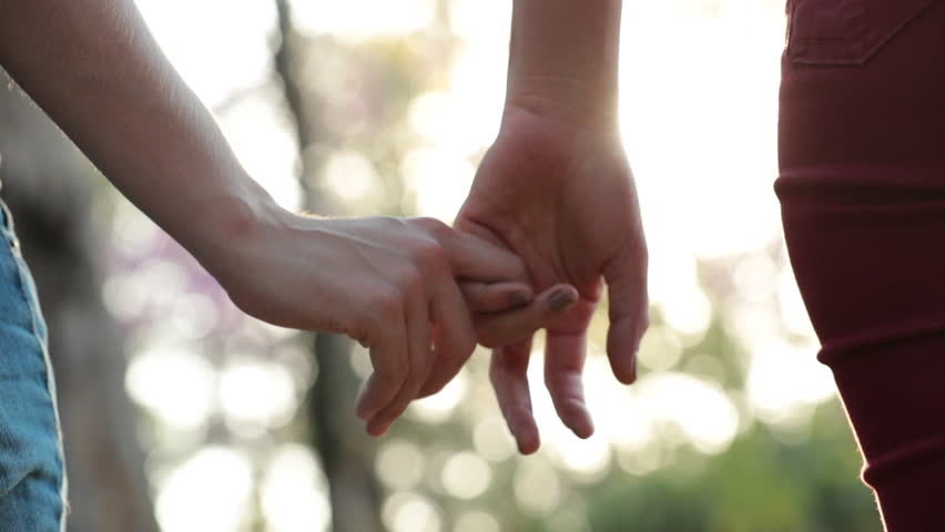 Close-up of disjoining hands, letting go of hands together #1014812699