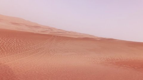 Traveling on an off-road car on the sand of the Rub al Khali desert stock footage video