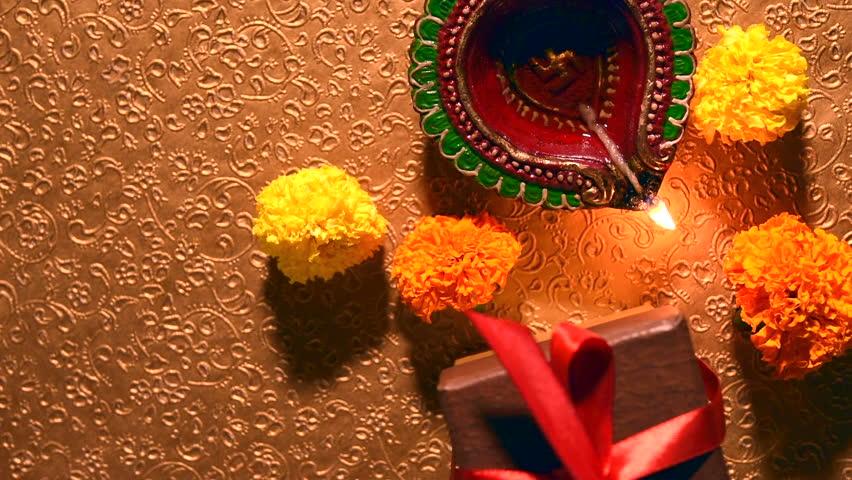 Diwali diya or oil lamp with flowers, gifts etc