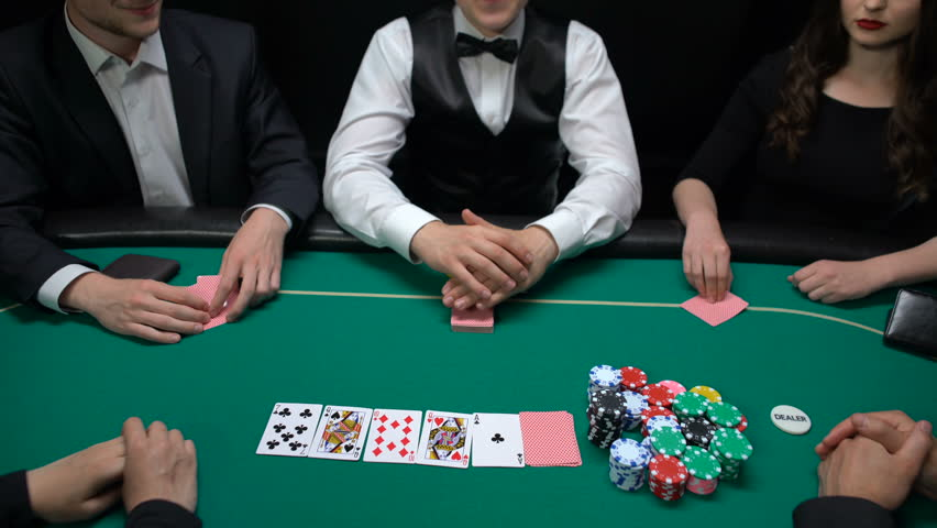 Risky casino players putting money and house key on table, raising bet, strategy | Shutterstock HD Video #1014833959