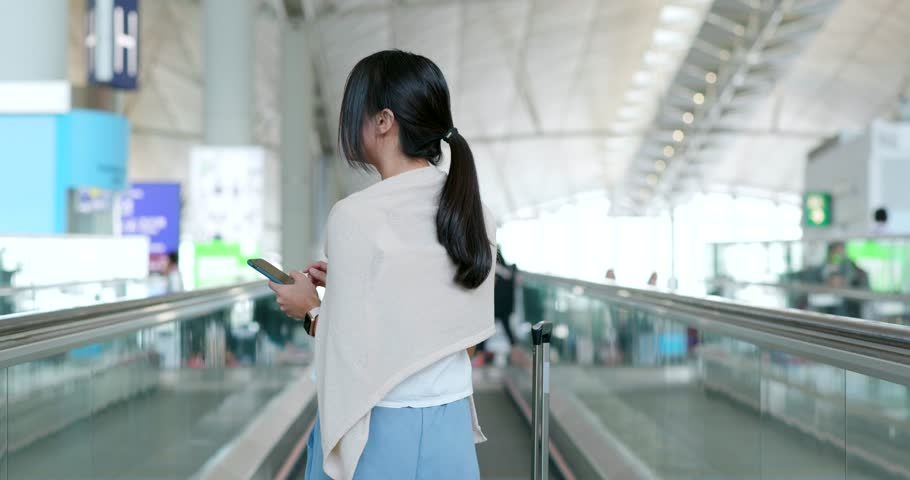 Woman use of mobile phone in the airport | Shutterstock HD Video #1014835459