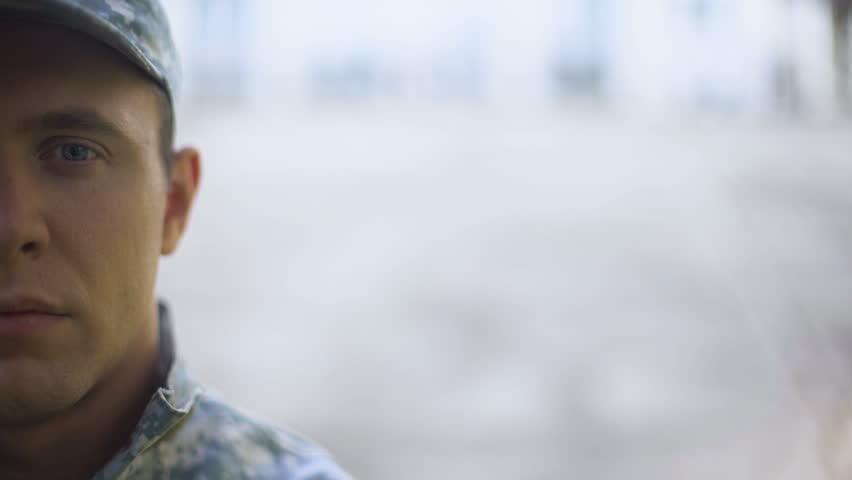 Male soldier looking at camera, military mission, armed forces conscription   Shutterstock HD Video #1014838129