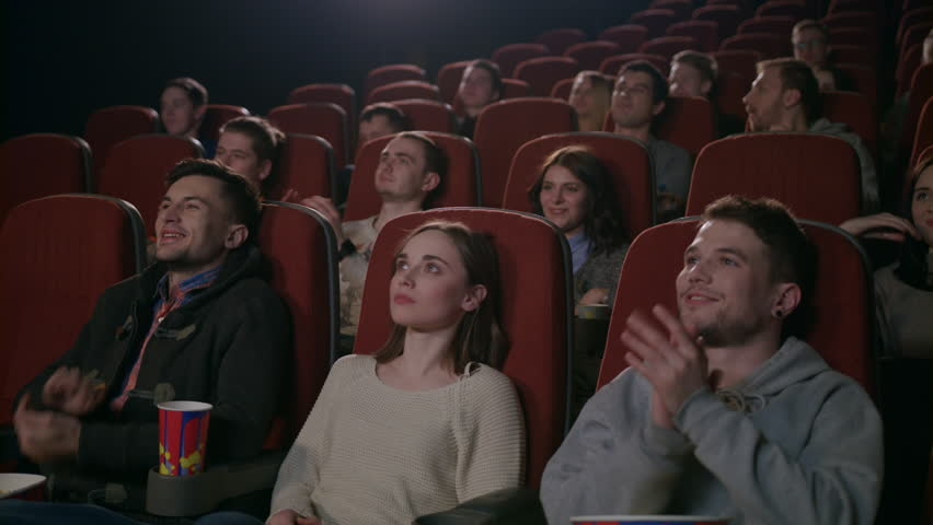 Funny spectators applaud play of actors in theater. People applauding at cinema theatre in slow motion. Young people clapping hands at theater   Shutterstock HD Video #1014864649