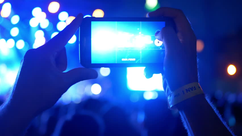 People use smart phones record video at music concert   Shutterstock HD Video #1014885769