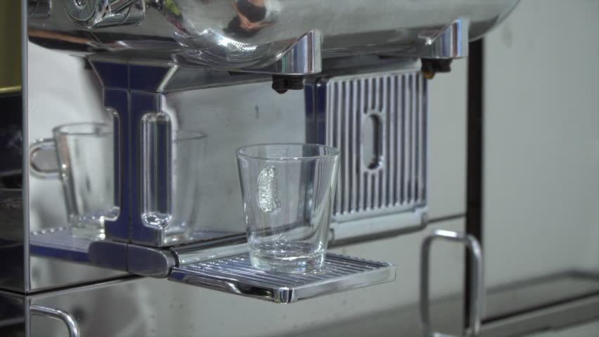 Espresso machine pouring fresh italian coffee in a cafe. | Shutterstock HD Video #1014922519