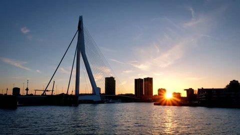 Rotterdam cityscape and Erasmus bridge silhouette over Nieuwe Maas on sunset. Rotterdam, Netherlands