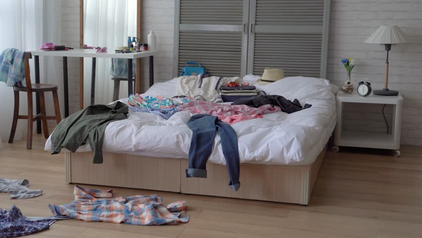 Busy house owner has no time to clean up her room. Is is really a disaster. | Shutterstock HD Video #1015020949