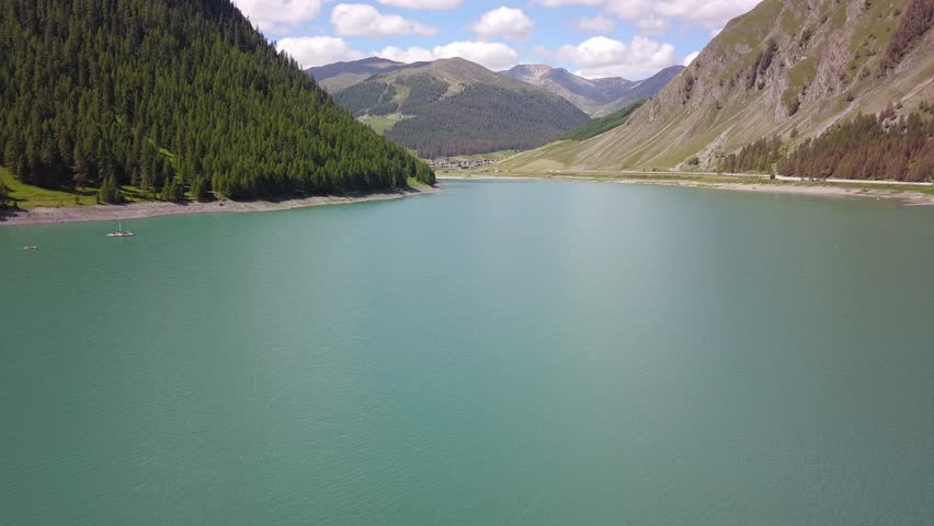 Drone aerial view of the Lake Livigno an alpine artificial lake. Italian Alps. Italy