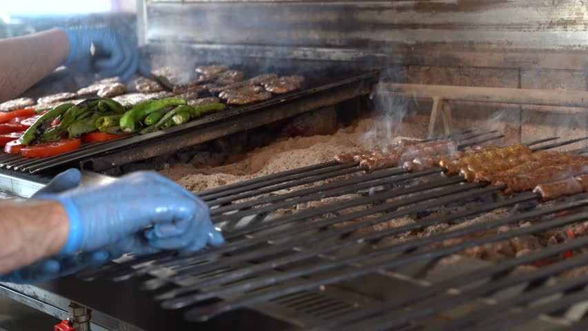 Traditional Turkish cuisine cooked in Adana Kebab grill. 4K video   Shutterstock HD Video #1015026229