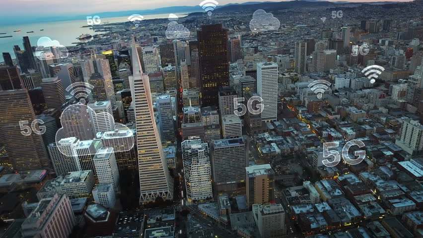 Aerial city connected through 5G. Wireless network, mobile technology concept, data communication, cloud computer, artificial intelligence, internet of things. Futuristic city. San Francisco skyline.