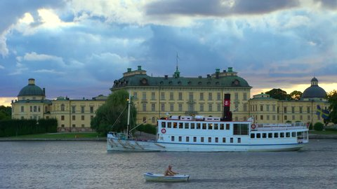Drottningholm, Sweden - AUGUST 15, 2018: Steamboat and rowboat by Drottningholm Palace.