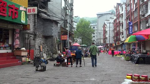 FENGHUANG, - OCTOBER 08: Street farmers market of Fenghuang Old Town. October 08, 2017 in Fenghuang, Xiangxi, Hunan, China