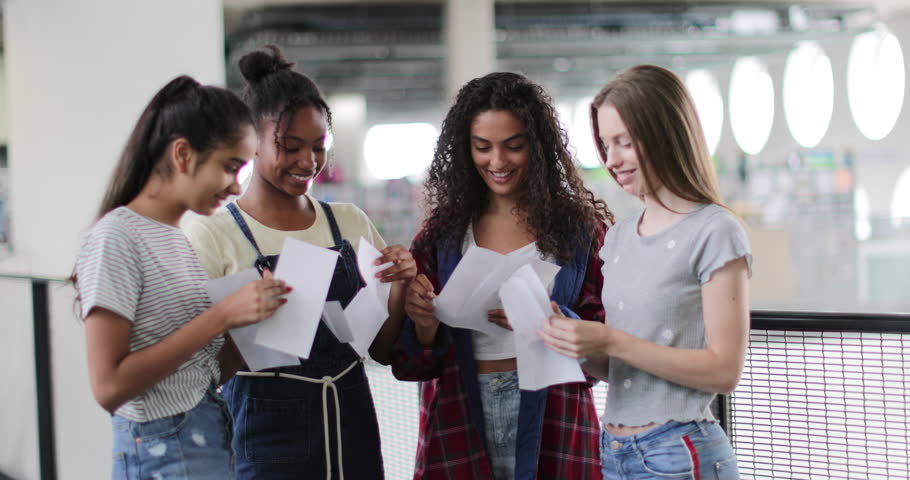 High school female students opening their exam results