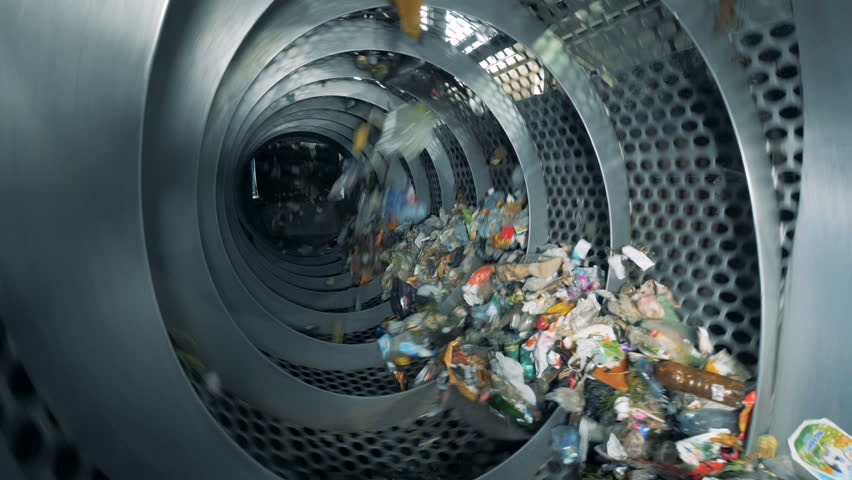 Trash is revolving inside an industrial recycling machine. Waste recycling equipment. | Shutterstock HD Video #1015111579