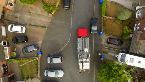Aerial View, footage of Dustmen putting recycling waste into a garbage truck, Bin men, refuse collectors. bin lorry, Recycling day, Video No1 of 8