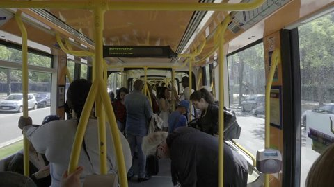 PARIS - MAY 3, 2018: crowded bus - passengers standing up - riding - Paris France Europe 1080 HD. Paris has an area of 41 square miles and a population of 2,206,488.