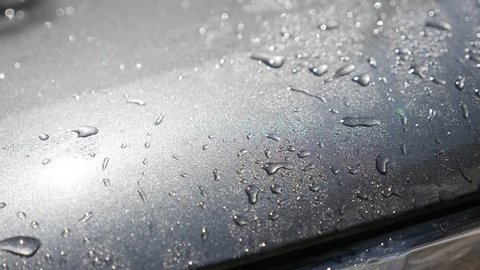 Waxed car hood surface washing with automatic pressure washer slow-mo video