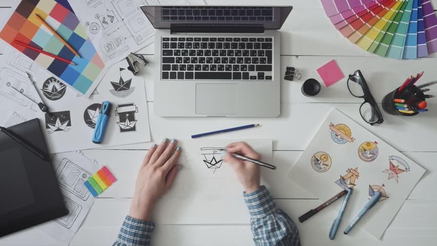 Creative designer working on a logo design #1015191649
