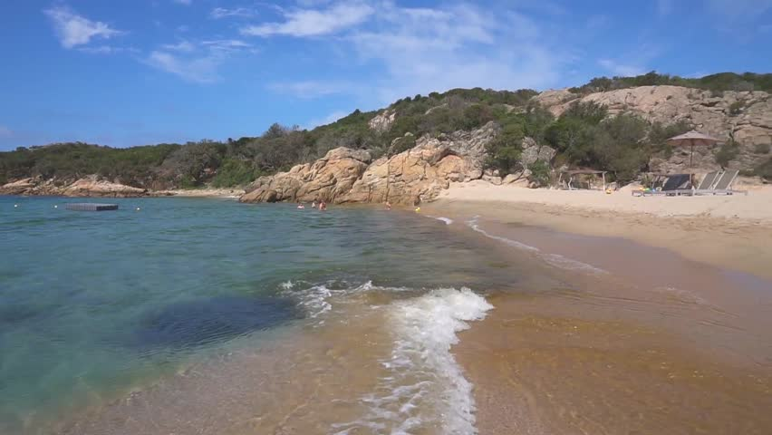 Beautiful panorama of the sandy beach in the corsica. sand. sea. sky. beautiful beach. chaise lounges. Sun protection. a great place to relax