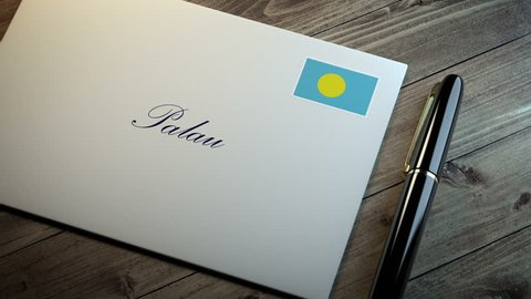 Country name written on a card or envelope in cursive font with a sleek pen on a wooden table surface under beautiful classy light. Stamp in the corner shows the flag of Palau