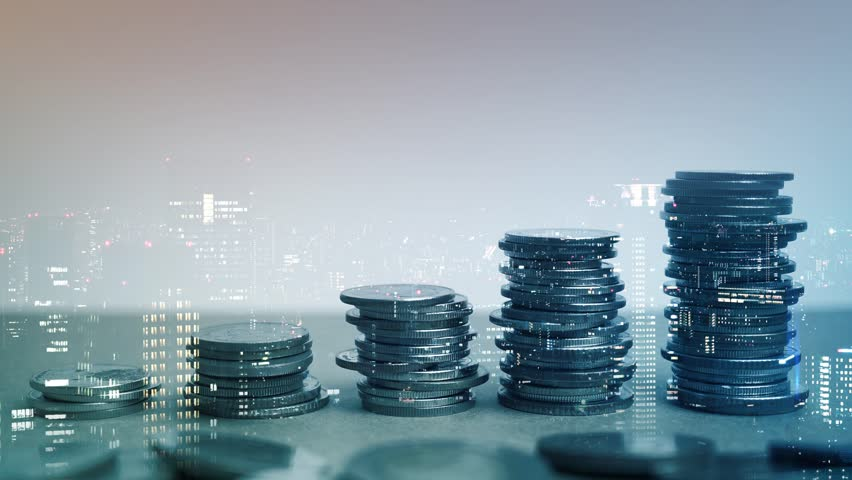 Double exposure of city view, rows of coins for finance and business concept