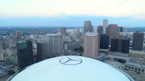 NEW ORLEANS, LOUISIANA, USA - AUGUST 1, 2018: Aerial pull out shot Mercedes benz Superdome sports stadium 4k