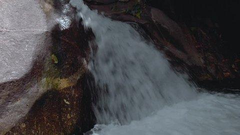 Aerial footage of Wang Mai Pak waterfall in Khiriwong village, Thailand