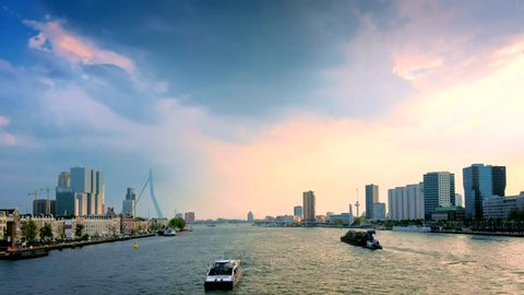 View of Rotterdam cityscape and Erasmus bridge over Nieuwe Maas with ships and boats. Rotterdam, Netherlands
