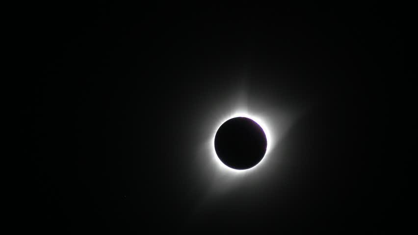Sun cresting during total solar eclipse | Shutterstock HD Video #1015370869