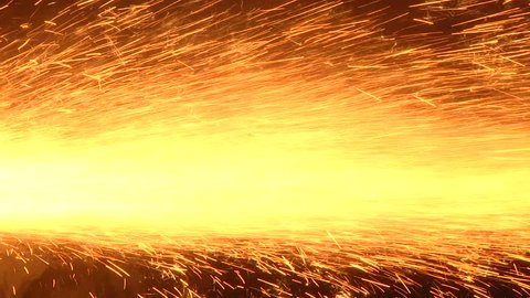 Casting shop for gassified models. Fire sparks from under the abrasive wheel. The process of grinding cast iron products. Grinding on a surface grinding machine.