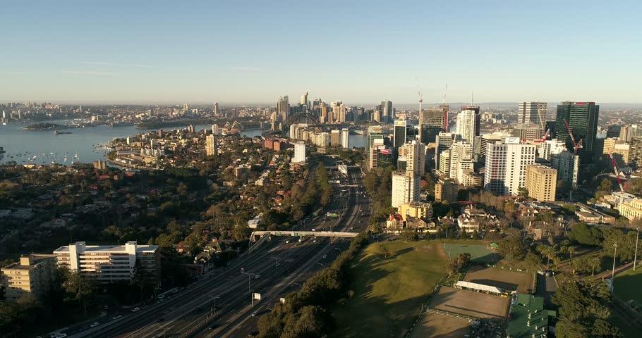 Modern expansion of Sydney city CBD on lower north shore – North Sydney CBD along Warringah freeway near sport grounds and oval.